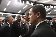 A member of the Secret Service on the job as President Obama shakes hands at the White House Summit for jobs and economic growth in Washington DC on December 3, 2009.  Photograph by Dennis Brack