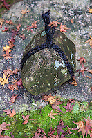 """Tobe Ishi is a stone is wrapped in rope and placed in a path or in front of a gate. They're sometimes called """"stop stones"""" sekimori-ishi indicating that entry is forbidden. They are commonly found at temples,  tea houses or traditional Japanese gardens."""