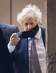 © Licensed to London News Pictures. 26/11/2020. London, UK. Prime Minister Boris Johnson removes his face mask as he arrives at Parliament for the first time after ending his 14 day isolation. The Prime Minister self isolated in his flat in Downing Street after meeting with an MP who later tested positive for Covid-19. Photo credit: Peter Macdiarmid/LNP