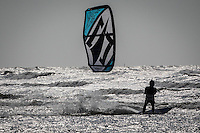 A kitesurfeur rides at the beach of Zeebrugge, Belgium, 8 June 2013. Kiteboarding will make its Olympics debut in Rio on 2016.