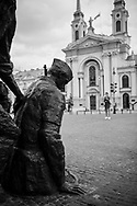 A woman standing in Warsaw's Krasiński Square looks toward the Warsaw Uprising Monument, dedicated to the Warsaw Uprising of 1944. Sculpted by Wincenty Kućma, it was unveiled in 1989.