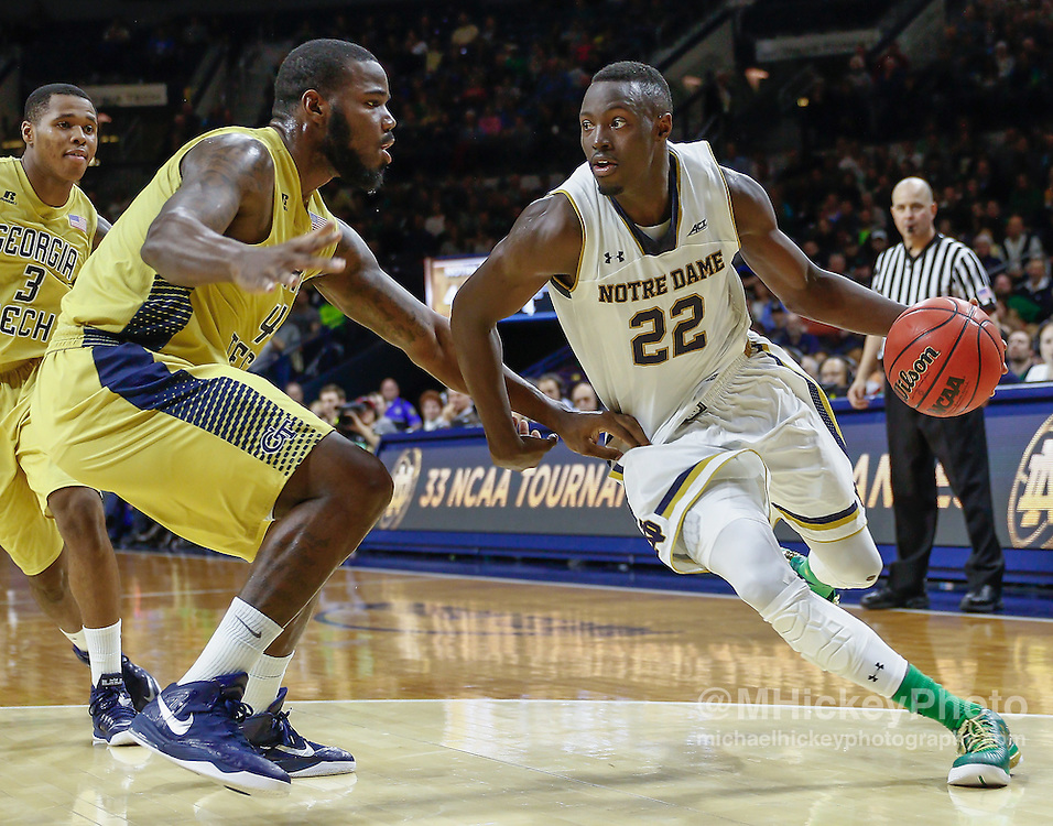 SOUTH BEND, IN - JANUARY 03: Jerian Grant #22 of the Notre Dame Fighting Irish drives to the basket against Demarco Cox #4 of the Georgia Tech Yellow Jackets at Purcell Pavilion on January 3, 2015 in South Bend, Indiana. (Photo by Michael Hickey/Getty Images) *** Local Caption *** Jerian Grant; Demarco Cox