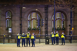 """© Licensed to London News Pictures. 20/03/2021. Manchester, UK. Police watch the protest from outside the nearby Midland Hotel but do not intervene . Thousands attend a """" Kill the Bill """" and Reclaim the Streets protest demonstration in St Peter's Square in Manchester City Centre in opposition to the Police, Crime, Sentencing and Courts Bill 2021 that is currently before Parliament and after the death of Sarah Everard in London . Photo credit: Joel Goodman/LNP"""