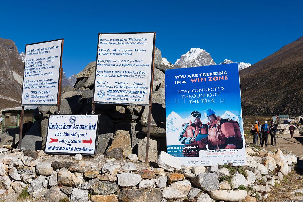 Signs for trekkers in Pheriche in the Nepal Himalaya. Photo © robertvansluis.com