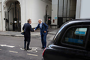 Two businessmen shake hands after meeting in a side street in the capitals financial district, on 5th October, 2017, in the City of London, England.