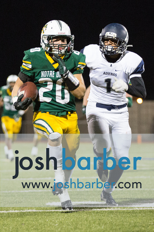 Notre Dame's Christian Gurrola (20), Aquinas' Miguel Flores (1) during the CIF-SS Boys Football Northwest Division Semifinal at J.W. North High School on Friday, November 27, 2015 in Riverside, California. (Photo/Josh Barber)