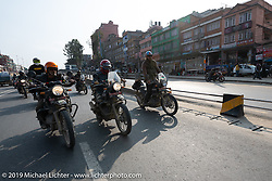 Cool Beans Chris, Danger Dan and Danita Gayle navigate the streets of Kathmandu on their Royal Enfield Enduros on Motorcycle Sherpa's Ride to the Heavens motorcycle adventure in the Himalayas of Nepal. Riding from Daman back to Kathmandu. Wednesday, November 13, 2019. Photography ©2019 Michael Lichter.