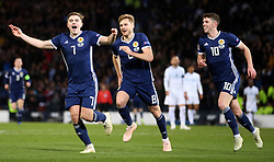 Scotland's James Forrest (left) celebrates scoring his side's second goal of the game with Stuart Armstrong (centre) and Ryan Christie during the UEFA Nations League, Group C1 match at Hampden Park, Glasgow.