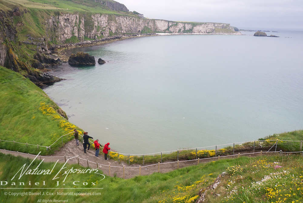 Exploring the coastline along The coastline along Carrick-a-rede Rope Bridge National Trust, Ireland.