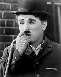 File photo dated circa 1934 of comic actor Charlie Chaplin, who has been commemorated with a blue plaque on the London mansion block where he lived with his brother.