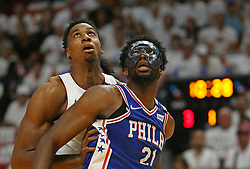 April 19, 2018 - Miami, FL, USA - The Miami Heat's Hassan Whiteside, left, fights for position under the basket against the Philadelphia 76ers' Joel Embiid during the first quarter in Game 3 of a first-round NBA playoff series at AmericanAirlines Arena in Miami on Thursday, April 19, 2018. (Credit Image: © David Santiago/TNS via ZUMA Wire)