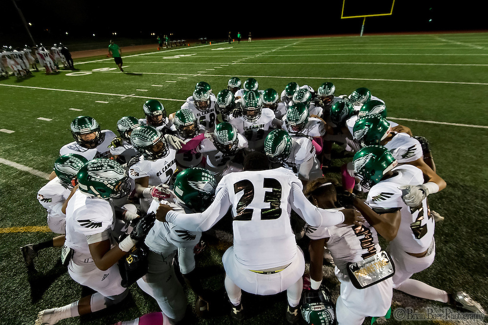 The El Camino Eagles pray before the game as the El Camino Eagles host the Rio Americano Raiders at Del Campo High School, Friday Oct 7, 2016. <br /> photo by Brian Baer