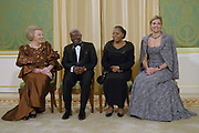 Queen Beatrix, prinsses Maxima and the president of Mozambique with his wife for a photoshoot at palace  Noordeinde.