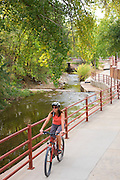 A visitor rides on a bike trail through downtown Moab, Utah.  (model released)