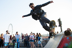 London, UK. 20th April 2019. A skateboarder uses the wooden ramp set up by climate change campaigners from Extinction Rebellion on Waterloo bridge as part of International Rebellion activities which have now lasted six days. Police officers today made a concerted attempt to try to clear the bridge of activists.