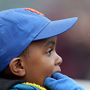 NEW YORK, NEW YORK - MAY 04:  A young fan watching the game during the Atlanta Braves Vs New York Mets MLB regular season game at Citi Field on May 04, 2016 in New York City. (Photo by Tim Clayton/Corbis via Getty Images)