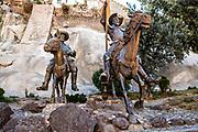 The life-sized statues of Don Quixote de la Mancha and Sancho Panza at the bottom of a rock cliff in the historic center of Guanajuato City, Guanajuato, Mexico.