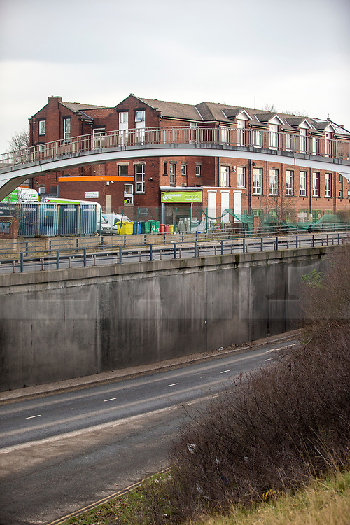 © Licensed to London News Pictures. 13/02/2019. Leeds UK. The scene on the A64 in Leeds where a man fell from a bridge & was taken to hospital with serious injuries & then arrested on suspicion of murder, he continues to receive treatment under police guard. Police have remained at the scene in Athlone Grove in Leeds this morning after the body of a woman was found inside a block of flats. A man has been arrested on suspicion of murder after he fell from a bridge over the A64 in Leeds. Photo credit: Andrew McCaren/LNP