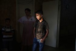 Iraqi refugee Ahmad Thamer, 13, is seen before the first day of school in Amman, Jordan, Aug. 19, 2007. His family fled the violence in Baquba, Iraq two years ago and are waiting for asylum from the U.N. Refugee Agency so they can finally make a permanent home.