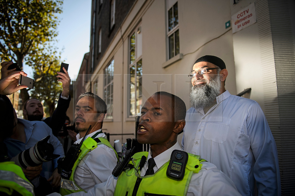 **2018 Pictures of the year by London News Pictures**<br /> © Licensed to London News Pictures. 19/10/2018. London, UK. Radical preacher ANJEM CHOUDARY is seen surround by security at a bail hostel after being released form Belmarsh Prison in south-east London. Choudary was jailed in 2016 for inviting support for for Islamic State of Iraq and the Levant (ISIS). Photo credit: Ben Cawthra/LNP