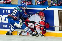 Matt Siddall (KHL Medvescak Zagreb, #39) vs Jaka Ankerst (HK Acroni Jesenice, #26) during ice-hockey match between KHL Medvescak Zagreb and HK Acroni Jesenice in 39th Round of EBEL league, on Januar 8, 2012 at Arena Zagreb, Zagreb, Croatia. (Photo By Matic Klansek Velej / Sportida)