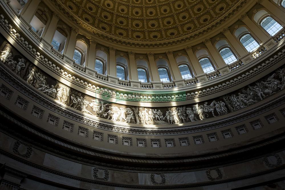 July 24, 2017 - Washington, District Of Columbia, USA - Late afternoon light illuminates the bust on the United States Capitol Building Rotunda. (Credit Image: © Alex Edelman via ZUMA Wire)