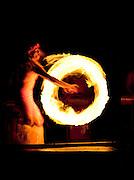 Fire Dancer performing at the Smith Family Garden Luau, Kaua'i, Hawai'i