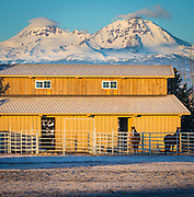 Horse stable and the South and North Sister peaks in Oregon behind it