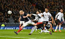 Scotland's Steven Naismith (left) attempts a headed shot on goal during the UEFA Nations League, League C Group one match at Hampden park, Glasgow.