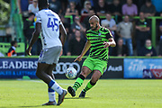 Forest Green Rovers Matt Mills(5) passes the ball forward during the EFL Sky Bet League 2 match between Forest Green Rovers and Colchester United at the New Lawn, Forest Green, United Kingdom on 14 September 2019.