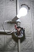 a bare light bulb on the ceiling