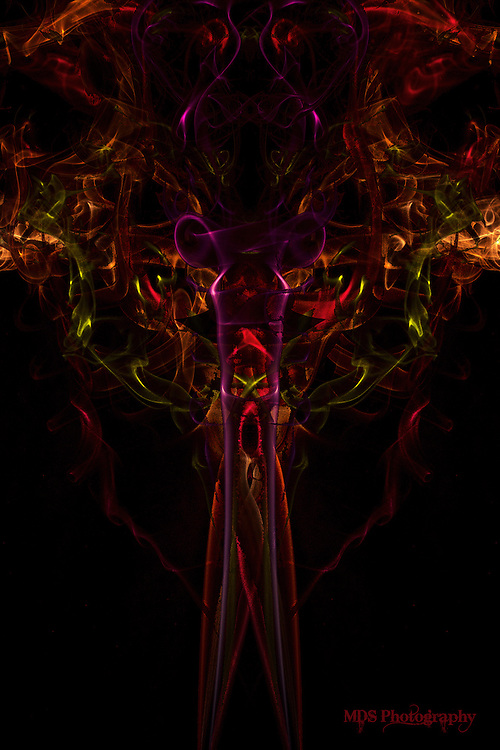 """My artistic vision of a """"Dream Wraith"""" created from a composite of several shots of smoke colorized and carefully layered and positioned to create the final image."""
