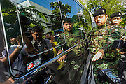 23 MAY 2014 - BANGKOK, THAILAND: A van carrying Thai civilian politicians tries to drive through a crowd of journalists and military police near a checkpoint in Bangkok. The Thai military seized power in a coup Thursday evening. They suspended the constitution and ended civilian rule. This is the 2nd coup in Thailand since 2006 and at least the 12th since 1932.    PHOTO BY JACK KURTZ