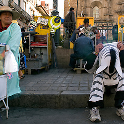 La Paz, Bolivia - March 27, 2008 - Luis Quispe Mamani, 19, adjusts his zebra head, in front of the Catedral of La Paz on the Plaza Murillo...Photo by Susana Raab