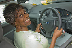 Older woman driving her car,