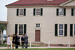 Doug Bradburn, president and chief executive officer of George Washington's Mount Vernon, from right, Emmanuel Macron, France's president, U.S. President Donald Trump, U.S. First Lady Melania Trump, Brigitte Macron, France's first lady, and Sarah Miller Coulson, regent with the Mount Vernon Ladies' Association, tour outside the Mansion at the Mount Vernon estate of first U.S. President George Washington in Mount Vernon, Virginia, U.S., on Monday, April 23, 2018. As Macron arrives for the first state visit of Trump's presidency, the U.S. leader is threatening to upend the global trading system with tariffs on China, maybe Europe too. Photographer: Andrew Harrer/Bloomberg