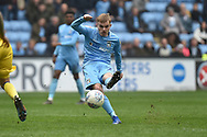 Coventry City midfielder (on loan from Derby County Luke Thomas (23) takes a shot at goal during the EFL Sky Bet League 1 match between Coventry City and Bristol Rovers at the Ricoh Arena, Coventry, England on 7 April 2019.