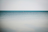 Lone silhouette surrounded by sea waters, Koh Samui, Thailand, Southeast Asia