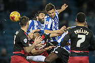 Vincent Sasso (Sheffield Wednesday) gets a header in on goal near the end of the 90 minutes during the Sky Bet Championship match between Sheffield Wednesday and Queens Park Rangers at Hillsborough, Sheffield, England on 23 February 2016. Photo by Mark P Doherty.