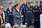 London, United Kingdom.    2014 Varsity Boat Race between Oxford University and Cambridge University Boat Clubs, Championship Course, Putney to Mortlake,  River Thames;   Boat Race Umpire, Richard PHELPS, holds the Sovereign, preparing for the Toss, watched by the crews.11 :07:08 - Sunday  - 06/04/2014  [Mandatory Credit; Intersport Images].<br /> OUBC. Bow. Storm URU, 2. Tom WATSON, 3. Karl HUDSPITH, 4. Thomas SWARTZ, 5. Malcolm HOWARD, 6. Mike DI SANTO, 7. Sam O'CONNOR, Stroke. Constantine LOULOUDIS and Cox Laurence HARVEY.