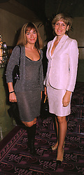 Left to right, MISS TARA PALMER-TOMKINSON and her sister MISS SANTA PALMER-TOMKINSON at a fashion show in London on 11th September 1998.<br /> MJW 10