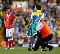 Photo: Ed Godden.<br /> Brazil v Wales. International Friendly. 05/09/2006.<br /> A Brazil fan is wrestled to the ground after running onto the pitch.