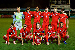 RHYL, WALES - Wednesday, November 14, 2018: Wales' players line up for a team group photograph before the UEFA Under-19 Championship 2019 Qualifying Group 4 match between Wales and Scotland at Belle Vue. Back row L-R: goalkeeper George Williams, Brandon Cooper, Ben Cabango, Morgan Boyes, Luke Jephcott, Neco Williams. Front row L-R: Dylan Levitt, Daniel Griffiths, captain Ryan Reynolds, Joseph Adams, Brennan Johnson. (Pic by Paul Greenwood/Propaganda)