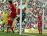 Photo. Aidan Ellis.<br /> Liverpool v Charlton Athletic.<br /> FA Barclaycard Premiership.<br /> 12/04/2004.<br /> Liverpool's Vladimir Smicer and keeper Jerzy Dudek cant keep out Charlton's Shaun Bartlett's header for the only goal