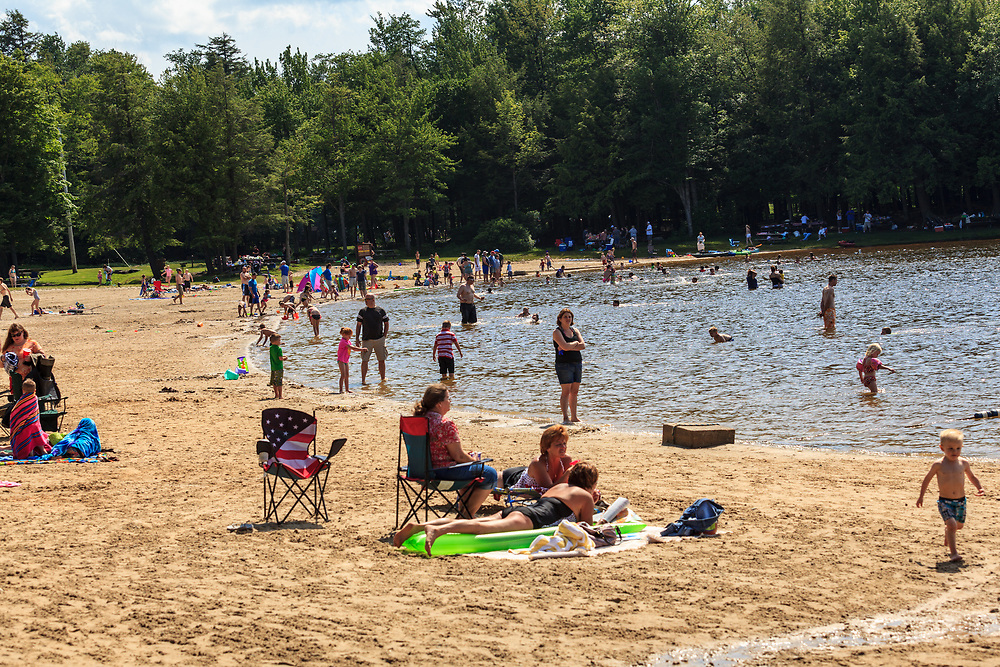 Benton, PA, USA - June 15, 2013: The beach area at the lake in Ricketts Glen State Park in northern Pennsylvania.