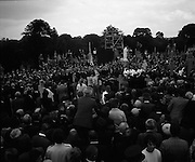 Funeral of Eamon DeValera.   (J72)..1975..02.09.1975..09.02.1975..2nd September 1975..Today saw the funeral of Eamon DeValera. He was laid to rest beside his wife Sinead in Glasnevin Cemetery,Dublin. Dignitries from all around the world attended at the funeral...Pictured, a hugh crowd surround the final resting place of Eamon DeValera