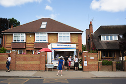 A refreshments stall erected outside a home on the main walk between Southfields station and the Wimbledon Championships at the All England Lawn Tennis and Croquet Club, Wimbledon. Photo credit should read: Katie Collins/EMPICS