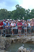 Manchester, TN.  2003 Bonnaroo Music Festival. Fans stand next to puddles after a rain storm while watching moe. perform at Bonnaroo 2004. Mandatory Credit: Bryan Rinnert/3Sight Photography..