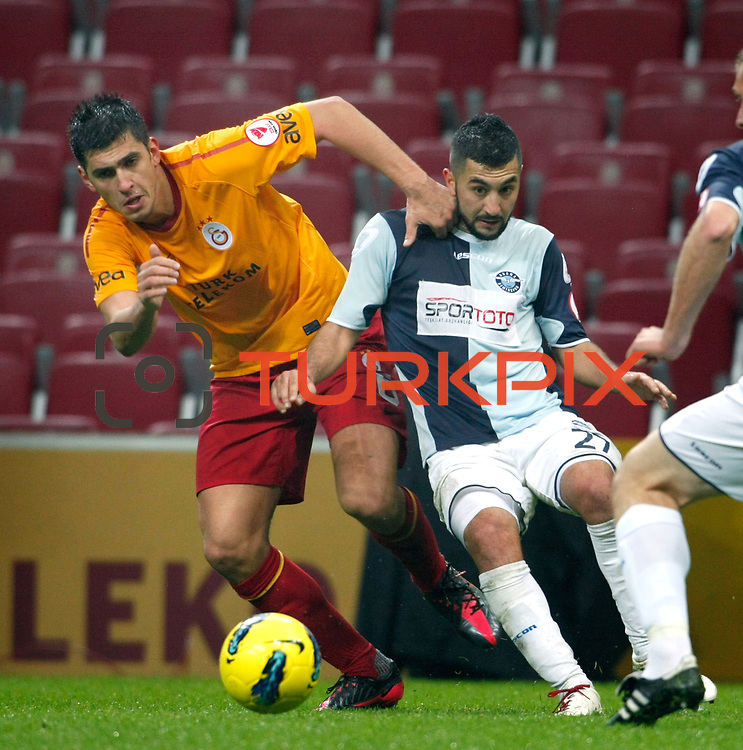 Galatasaray's Ceyhun Gulselam (L) and AdanaDemirspor's Tunay Acar (R) during their Turkey Cup matchday 3 soccer match Galatasaray between AdanaDemirspor at the Turk Telekom Arena at Aslantepe in Istanbul Turkey on Tuesday 10 January 2012. Photo by TURKPIX