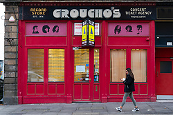 Dundee, Scotland, UK. 27 November 2020 . Views of streets of Dundee in Tayside on Black Friday sales with many shoppers buying Christmas shopping during a level 3 lockdown during Covid-19 pandemic.Pictured; Famous Groucho's record store is now closed. Iain Masterton/Alamy Live News